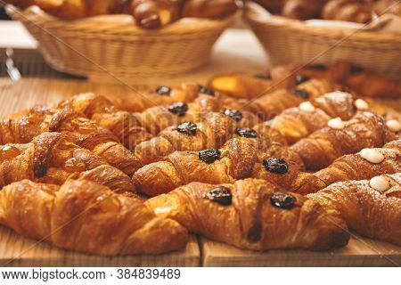 Various Flavours Of Croissant In A Bakery