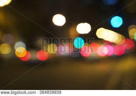 Abstract Bokeh Of Light, Blurred Defocused Lights Of Cars In Traffic Jam On A Wet Rainy Road Backgro