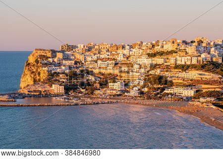 Peschici, Gargano, Puglia, Italy, July 2020: Aerial View Of Peschici At Sunset, Small Picturesque Vi
