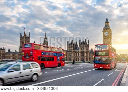 Houses Of Parliament With Big Ben And Double-decker Buses On Westminster Bridge At Sunset, London, U