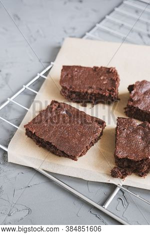 Homemade Chocolate Brownies Served On A Paper And Tray. Fudgy Chocolate Cake