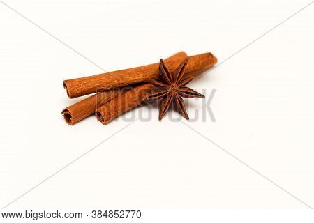 Cinnamon Sticks And Badyan On White Background.