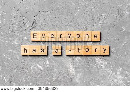 Everyone Has A Story Word Written On Wood Block. Everyone Has A Story Text On Cement Table For Your