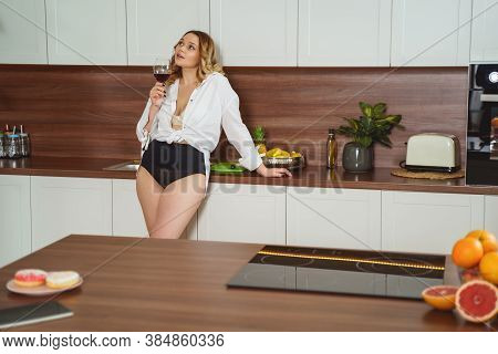 Beautiful Plump Woman Holding Bocal With Wine