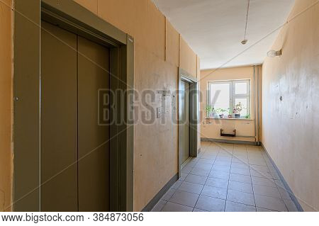 Russia, Moscow- February 15, 2020: Interior Public Place, House Entrance. Doors, Walls, Staircase Co