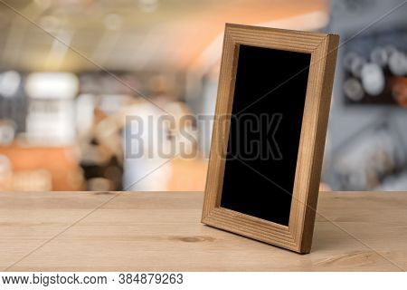 old photo frame on the wooden table in a night club