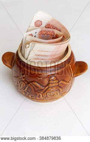 Russian Banknotes Of Five Thousand Rubles In Large Quantities In A Ceramic Pot