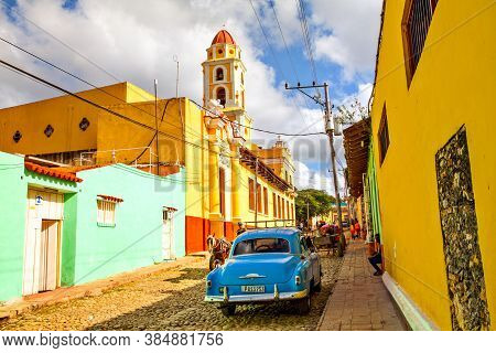 Local People And Colorful Houses In The Colonial Town Of Trinidad, Cuba
