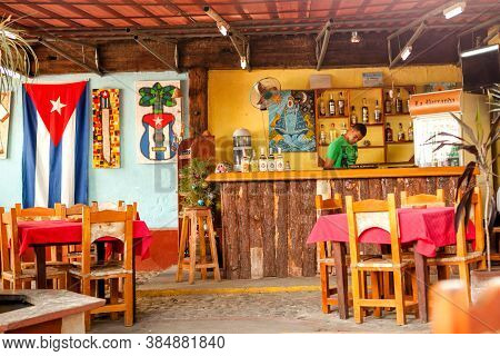 Trinidad, Cuba - December 18, 2016: Barkeeper In A Bar/ Restaurant In Trinidad, Cuba
