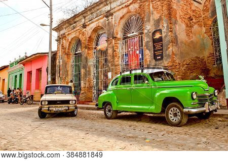Trinidad, Cuba - December 18, 2016: Classic Cars In The Street Of The Colonial Town Trinidad (unesco