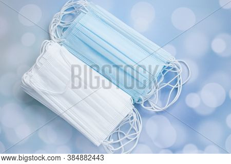Protective Medical Mask And Medications For Doctors. Antiseptic Gloves And A Thermometer