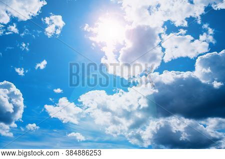 Blue sky background, clouds lit by bright sunlight. Vast sky landscape panoramic scene. Blue sky landscape, bright sky scene, Cloudy sky view, sky background. Vast sky panoramic scene