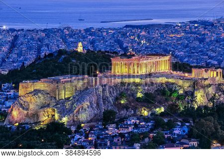 Close View Of Acropolis Hill With Parthenon And Erechtheion And Philoppapos Monument At Night, Athen