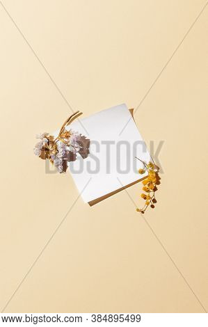 Empty White Note Paper And Dried Flowers For Design Mood Board. Memory Inspiration Concept.