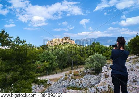 Female Tourist Dressed In Black Shoots A View Acropolis And Lycabettus Hill In Athens, Greece From P