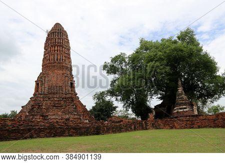 The Main Phra Prang Or Pagoda And Small Stupa Beside The Main In The Ruins Of Ancient Remains At Wat