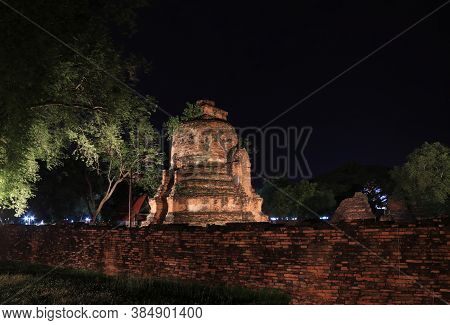 Night Shot Of Incomplete Small Stupa Beside The Wall In The Ruins Of Ancient Remains At Wat Phra Si