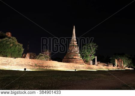 Night Shot Of Incomplete Small Stupa In The Ruins Of Ancient Remains At Wat Mahathat Temple, It Buil