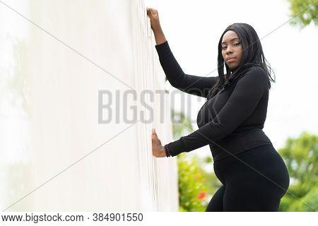 Portrait Of Beautiful African Fat Woman Standing Outdoor. Black People