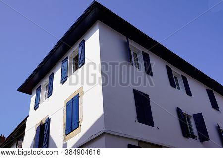 Traditional Bask White Facades With Colorful Blue Shutter In Basque Country France