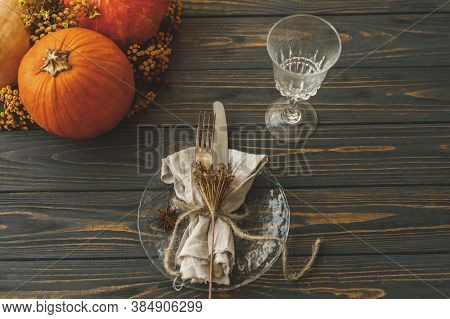 Eco Friendly Thanksgiving Dinner Table Setting. Stylish Plate With Cutlery, Linen Napkin With Herb A