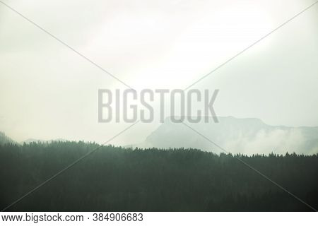 Gloomy And Frightening Mountains In The Fog