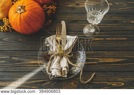 Thanksgiving Dinner Table Setting. Stylish Plate With Cutlery, Linen Napkin And Pumpkin With Autumna