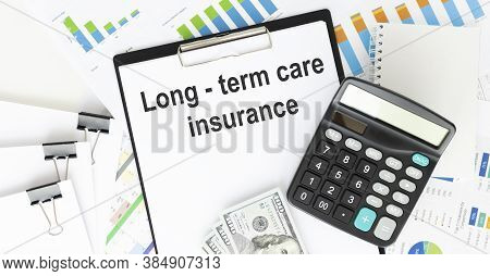 Text Long-term Care Insurance On Clipboard With Money On Wooden Table Closeup