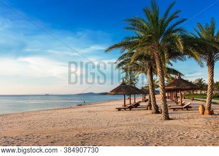 sun loungers and parasols on the sandy beach