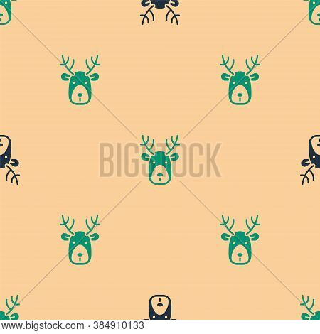 Green And Black Deer Head With Antlers Icon Isolated Seamless Pattern On Beige Background. Vector