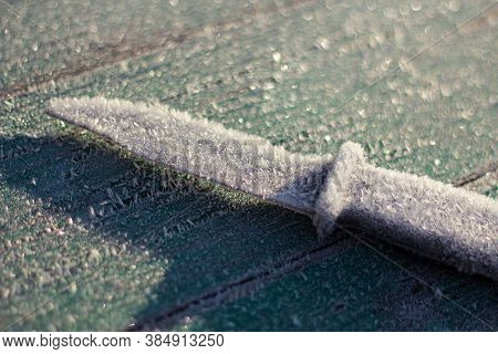 The Knife Is Covered With Frost. The First Frost In The Fall. Autumn Natural Background