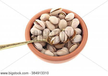 Pistachios In White Porcelain Bowls. Roasted Pistachio Seeds In Shells And Shelled. Green, Dried Fru