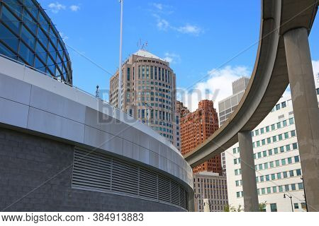 Detroit, MI USA - 8/30/2020:  Street view of Detroit skyline along with People mover
