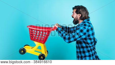 Mature Shopper Go Shopping In Mall. Bearded Man Carry Shopping Cart. Brutal Guy Making Purchase. Mal