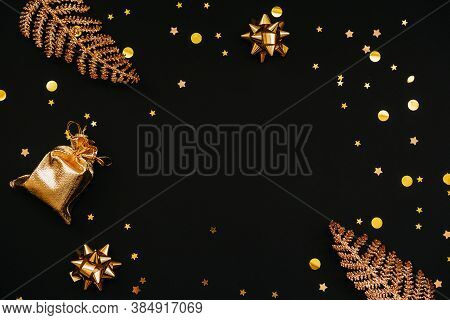 Various Festive Items And Decorations In Gold Color On A Dark Or Black Background. In The Middle The