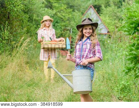 Loving Nature. Cute Gardener Concept. Gardener Occupation. Taking Care Of Plants. Sisters Helping At