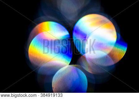 Lens Flare, Bokeh Lights. Reflections From Glass, Diamond, Crystal. Defocused Shining Colorful Rainb