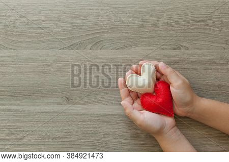 Hands Holding Two Hearts, Health Care, Love, Organ Donation, Csr Concept, World Heart Day, World Hea