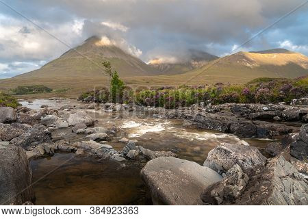 Beautiful Sligachan Waterfalls On The Isle Of Skye In The Highlands Of Scotland, The Cuillin Mountai