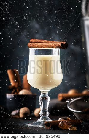 Eggnog Cocktail Hot Winter Or Autumn Drink With Milk, Eggs And Dark Rum, Sprinkled With Cinnamon And