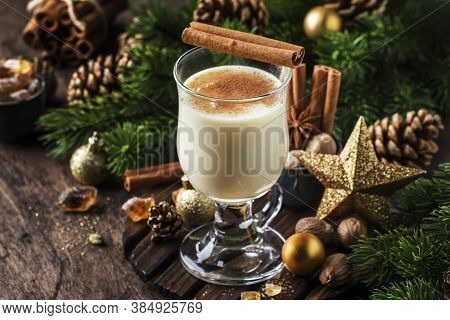 New Year Or Christmas Eggnog Cocktail - Hot Winter Or Autumn Drink With Milk, Eggs And Dark Rum, Spr