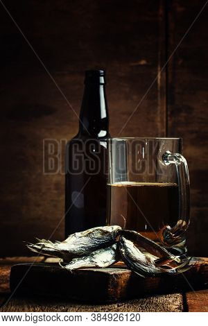 Russian Tradition: Dried Roach And Beer On Vintage Wooden Background, Selective Focus