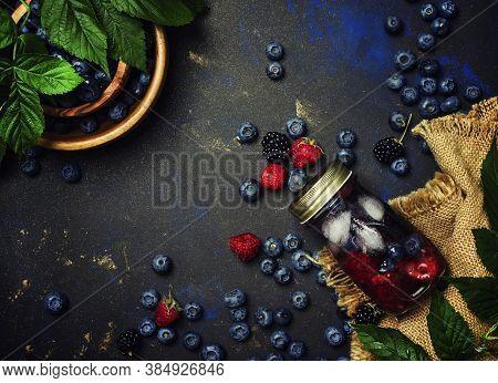 Summer Ice Berry Tea With Blueberries, Raspberries, Blackberries And Ice, Top View