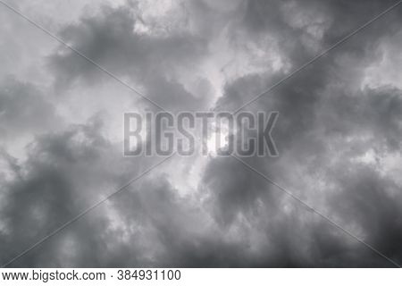 Dark Dramatic Cloudy Overcast Sky With Thunderstorm Clouds. Natural Bad Weather And Climate Sky Back