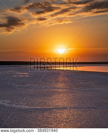Sunset On The Genichesk Pink Extremely Salty Lake (colored By Microalgae With Crystalline Salt Depos