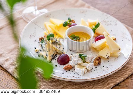 Cheese Platter. A Plate With A Variety Of Cheeses. Snacks. Glass Of Wine With Cheese.