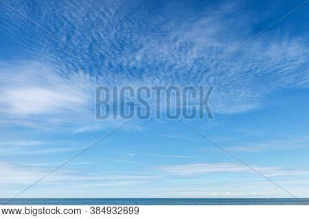 Beautiful Blue Sky With White Cirrus Clouds. Background Image