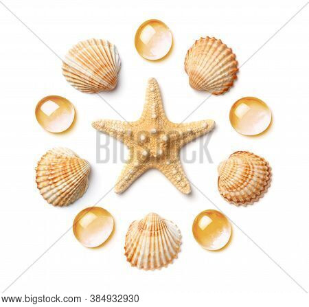 Pattern In The Form Of A Circle Of Sea Shells And Starfish, Isolated On A White Background. Flat Lay