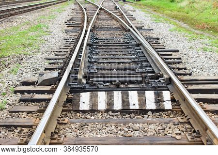 Rail Tracks With Rail Sleepers At The Railway Pointwork. Change Of Direction. Railway Arrows With Ra