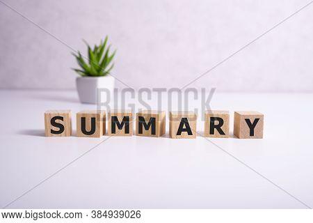 Summary Word Written On Wood Block On White